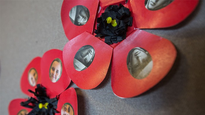 Handmade poppies with faces in the petals.